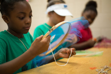 Students embroidering and appliquéing trash